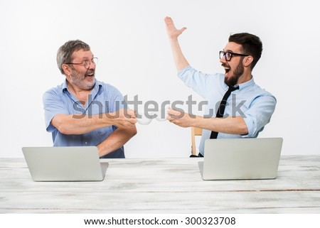 The two colleagues working together at office on white  background. both happy men are getting good news. concept of  success in business  - stock photo