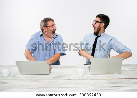 The two colleagues working together at office on white  background. both happy men are getting good news. concept of  success in business.  - stock photo