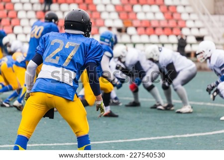 the two teams are ready to attack american football game - stock photo