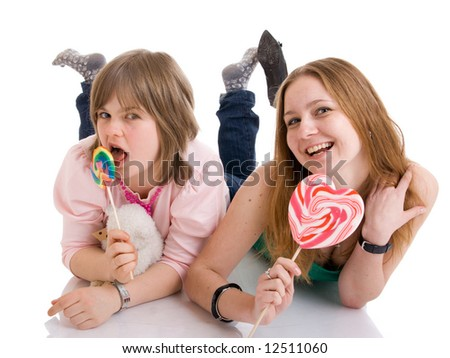 The two young attractive girls isolated on a white background