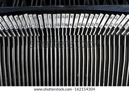 The Type Bar Characters on a Vintage Typewriter Author Writing Tool - stock photo