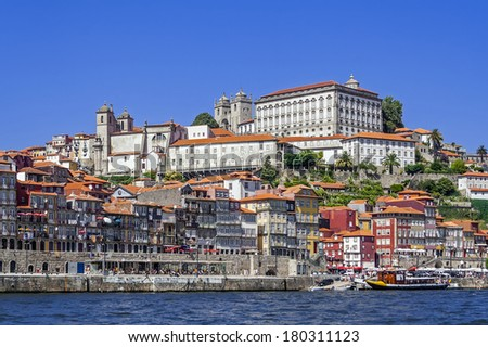 The typical colorful buildings of the Ribeira District and the Douro River in the city of Porto, Portugal. Unesco World Heritage.