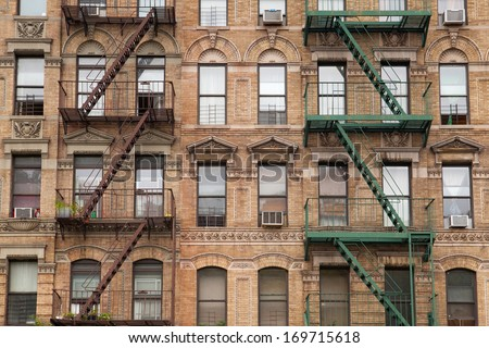 The typical old houses with fire stairs in New York in USA - stock photo
