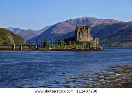 The typical scottish castle of Eilean Donan in a sunny summer day - stock photo