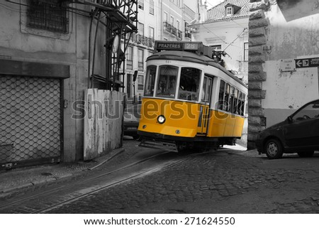 The typical yellow tramway of Lisbon - stock photo