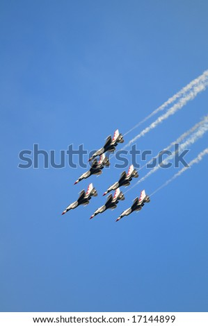 The U.S. Air Force Thunderbirds team shows aerobatic maneuvers in the sky on The great New England Air Show in Westover ARB, Massachusetts , USA, September 6th, 2008.