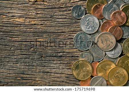 the U.S. coins on old wooden background - stock photo