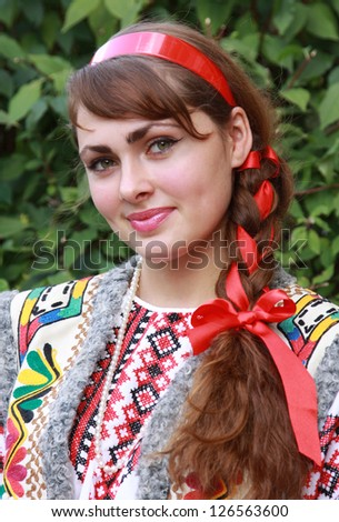 The Ukrainian girl in a national suit - stock photo