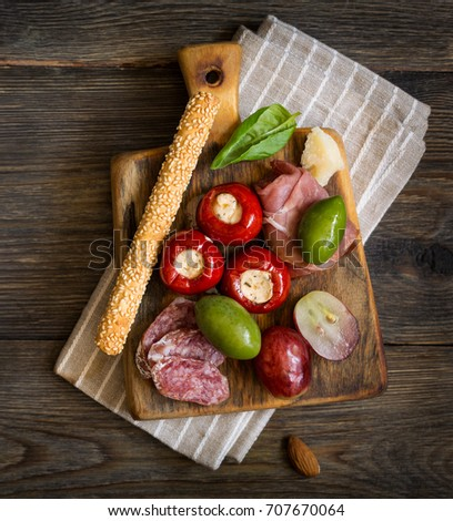 The ultimate appetizer board with cheese and meat. Antipasti.
