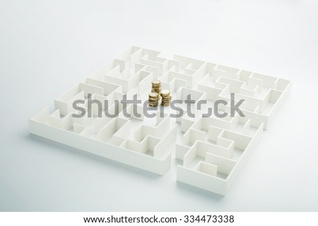 The uncertainty of money and business. Coins stack hidden inside a maze - stock photo