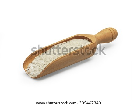 the uncooked white rice in wooden scoop