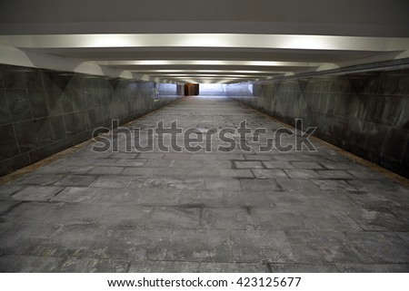 The underground passage lined with gray granite and marble