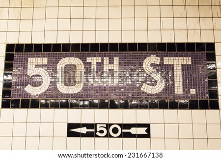 The underground wall mosaic of the direction to 50 th Street (New York). - stock photo