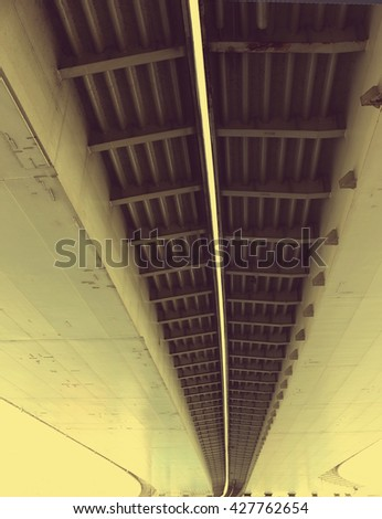 the underside of the viaduct; vintage filter effect - stock photo