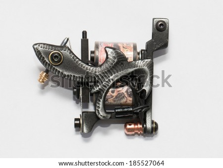 The unique professional tattoo machine ( gun ).