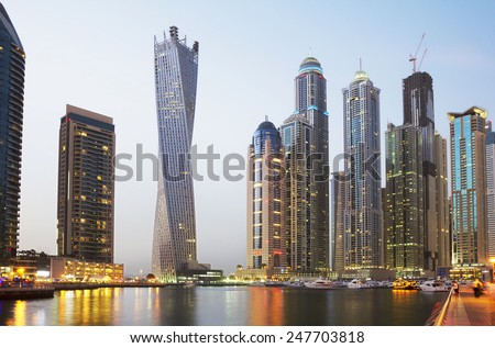 The United Arab Emirates. The Dubai Waterfront. On the banks of the lagoon Dubai are high-rise modern buildings to the waterfront moored a large number of boats . - stock photo