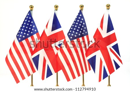 The United States and the United Kingdom flags hanging on the gold flagpole,Isolated on the white background - stock photo