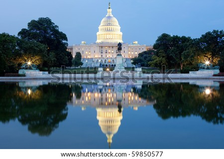 The United States Capitol building in Washington DC, USA - after dark with water reflection - stock photo