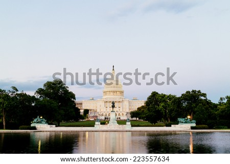 The United Statues Capitol, seen from the the Capitol Reflecting Pool, Washington DC, USA. - stock photo
