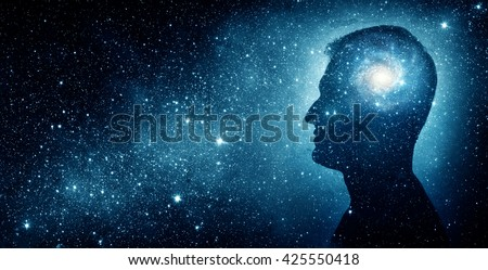 The universe within. Silhouette of a man inside the universe. The concept on scientific and philosophical topics. - stock photo