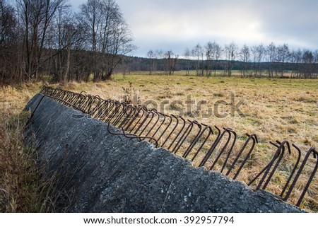 the unnecessary building construction litters a natural landscape - stock photo