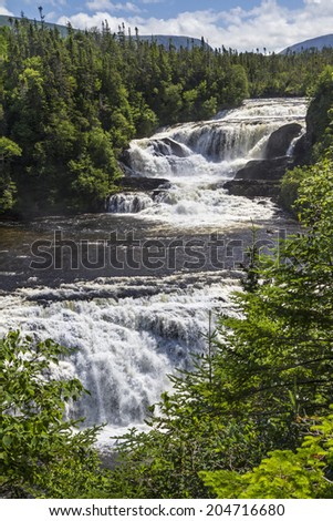 The upper and lower cascades of Baker's Brook Falls in Gros Morne National Park, Newfoundland, Canada - stock photo