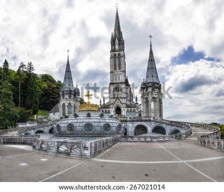 The Upper Basilica with gilded crown in Lourdes - stock photo
