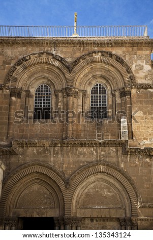 The upper part of the entrance to the Church of the Holy Sepulchre in the old city of Jerusalem. - stock photo