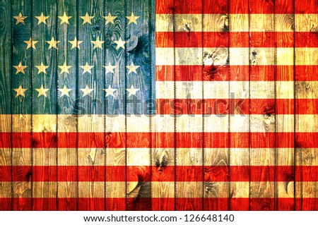 The USA flag painted on wooden pad - stock photo