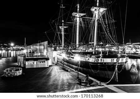 The USS Constellation at night, in the Inner Harbor of Baltimore, Maryland. - stock photo