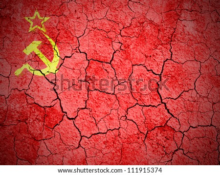 The USSR flag painted on  cracked ground with vignette - stock photo