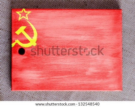 The USSR flag painted on  painted over wooden board - stock photo