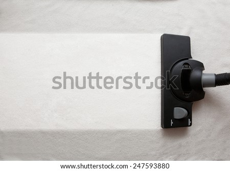 the vacuum cleaner brush to tidy up. - stock photo