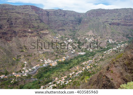 The Valle Gran Rey, the beautiful canyon on La Gomera is located on the west side of the island. Gomera has a unique nature that invites to hike. The terraces are still used for agriculture. - stock photo
