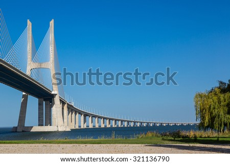The Vasco da Gama Bridge in Lisbon, Portugal in a summer day
