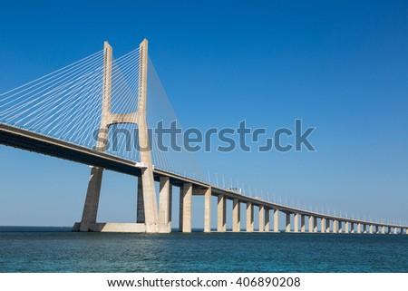 The Vasco da Gama Bridge in Lisbon, Portugal in a summer day - stock photo