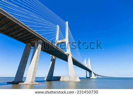 The Vasco da Gama Bridge in Lisbon, Portugal. It is the longest bridge in Europe - stock photo