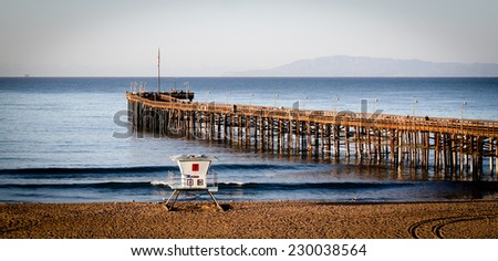 The Ventura Pier with Santa Cruz Island in the background - stock photo