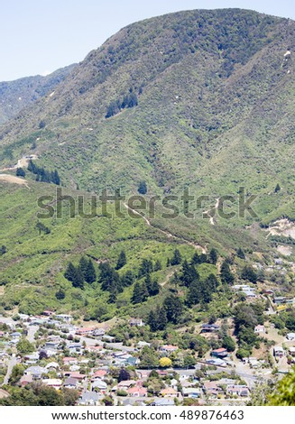 The vertical panoramic view of Picton resort town surrounded by mountains (New Zealand).
