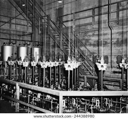 The vertical safety rods and the cables that support them at the top of the atomic pile of a reactor at the Manhattan Project Hanford site. February 1945. - stock photo