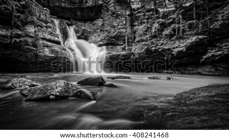 The very beautiful Cedar Falls  in Hocking Hills Ohio in black and white. Very popular tourist attraction.
