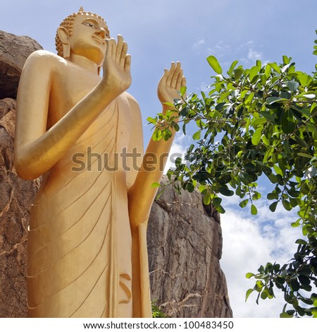 The Very large standing buddha situated in the Khao Takiab region of Hua Hin in Thailand. The area is also known as monkey or chopstick mountain. - stock photo