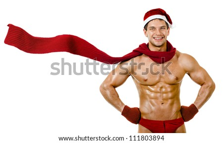 the very muscular  bronzed handsome sexy Santa Claus in red muffler on white  background, posture and smile, isolated - stock photo
