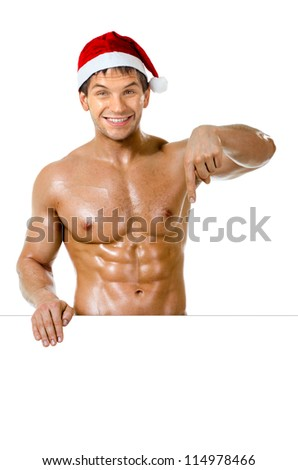 the very muscular  bronzed handsome sexy Santa Claus on white  background indicate finger down and smile, isolated