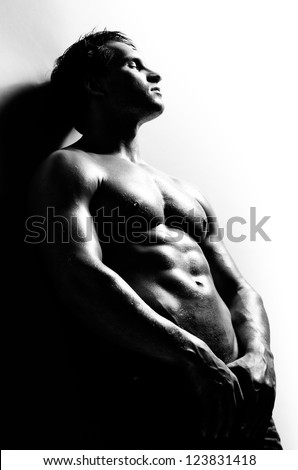 the very muscular handsome sexy guy ,  black-and-white photo - stock photo