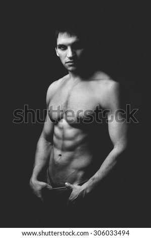 the very muscular handsome sexy guy, black-and-white photo - stock photo