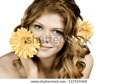 the very  pretty red-haired blue eyed young woman  with yellow flower,  smile , horizontal close up portrait - stock photo