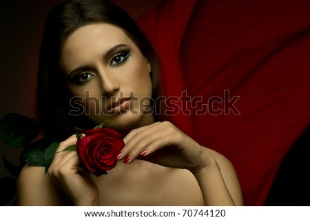 the very  pretty woman on dark red background, with rose, sensual sexuality gaze...