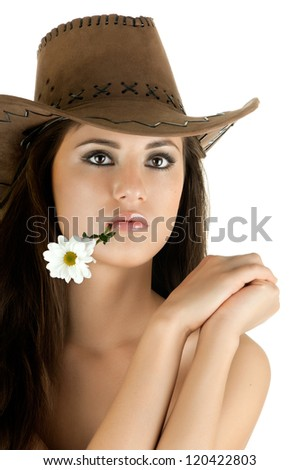 the very  pretty woman on white background in cowboy-hat, with camomile, sensual sexuality gaze, isolated