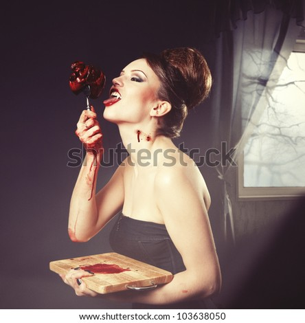 the very  pretty woman vamp, with fork and heart - stock photo